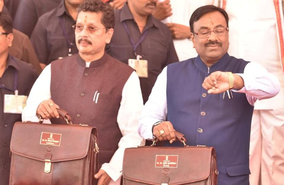 State Finance Minister Sudhir Mungantiwar (right) and MoS Deepak Kesarkar before presenting the state budget  on Saturday.