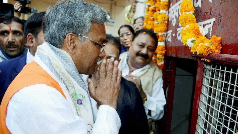Uttarakhand chief minister Trivendra Singh Rawat paying homage to martyrs before the swearing-in ceremony in Dehradun on Saturday.