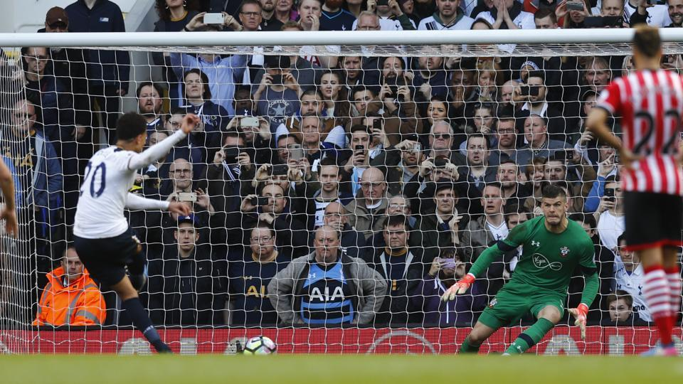 Tottenham Hotspur's Dele Alli scores their second goal from the penalty during the English Premier League match against Southampton F.C. on Sunday.