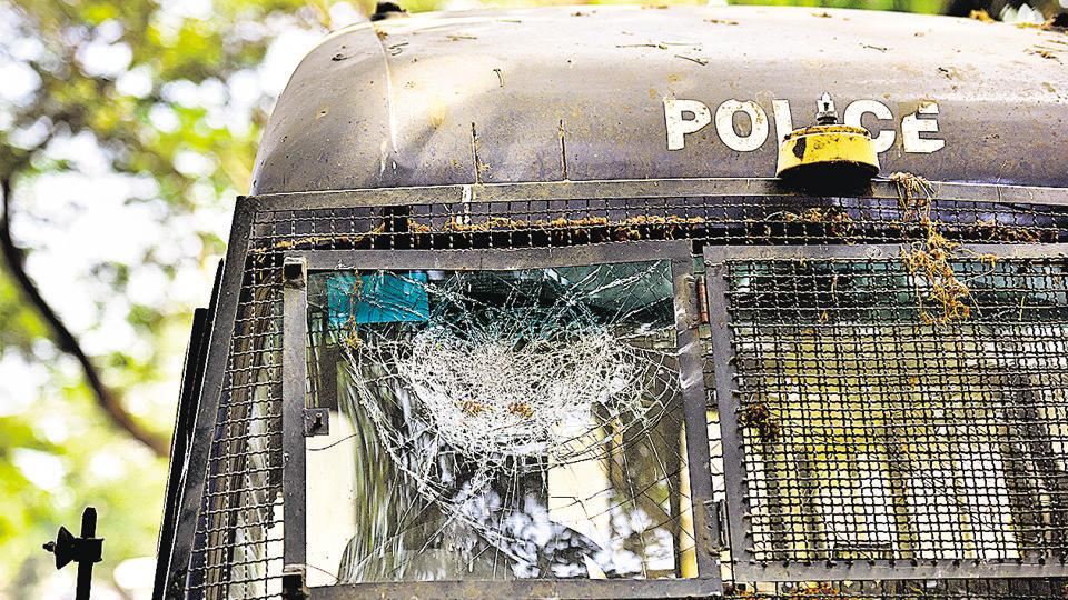 Several vehicles were damaged on Sunday after a crowd pelted stones and threw fireballs at the Trombay police station.