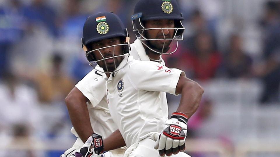 Wriddhiman Saha and Cheteshwar Pujara of India cricket team during Day 4 of the third Test vs Australia cricket team in Ranchi onSunday.