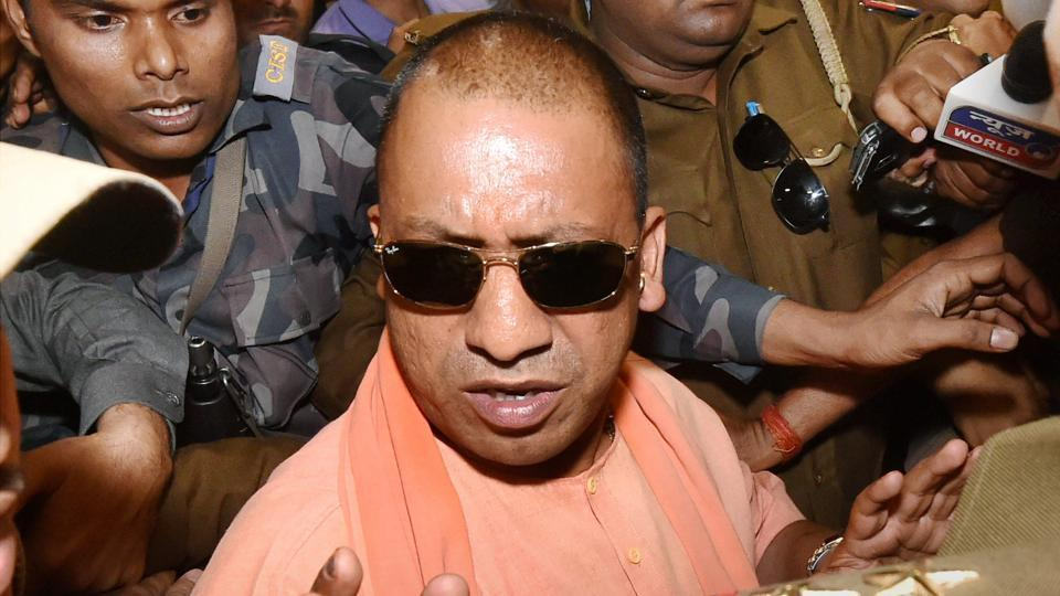 Yogi Adityanath arrives to attend BJP's legislature party meeting in Lucknow on Saturday.