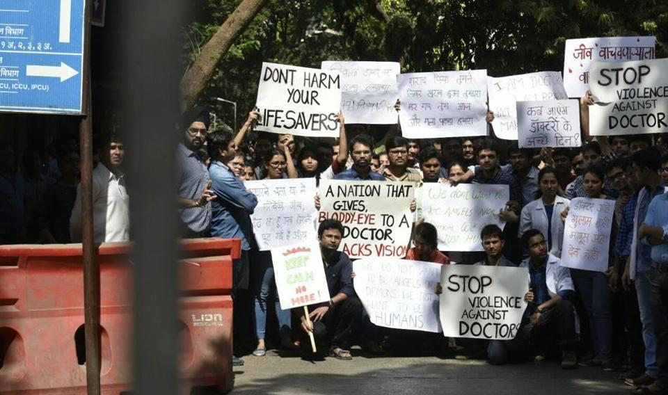 Resident doctors protest on Sion hospital campus against the growing number of attacks on doctors by relatives of patients.