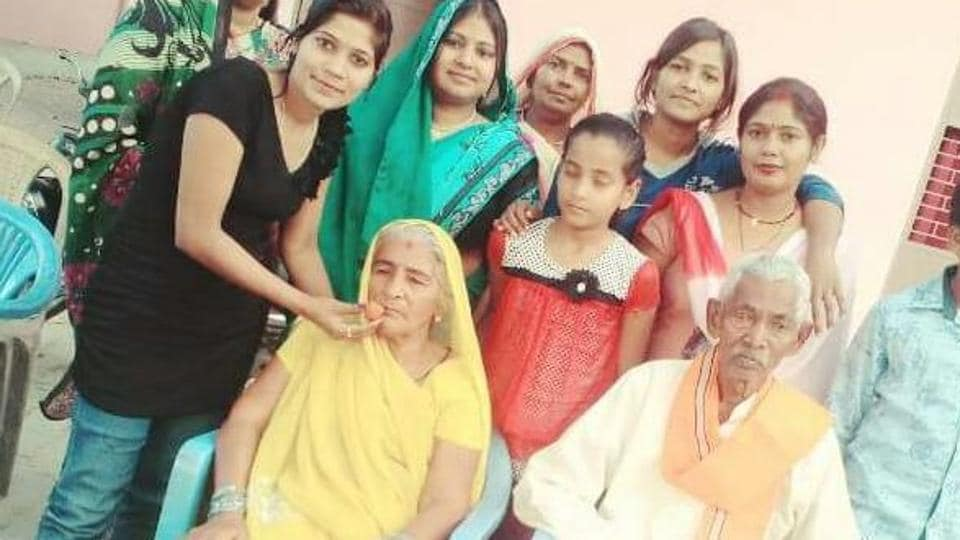 Keshav Prasad Maurya's parents (sitting) celebrating as Maurya was sworn in as deputy CM.
