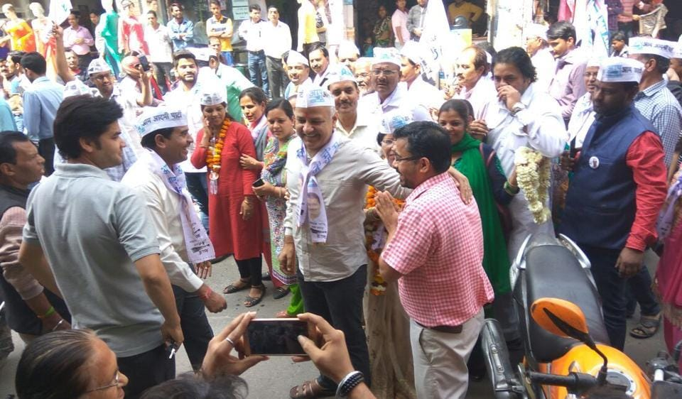 Delhi deputy chief minister Manish Sisodia was among several AAP ministers and MLAs who went from door-to-door on Sunday to campaign for the municipal elections.
