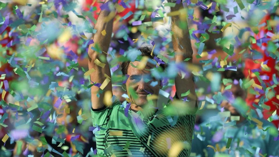 Roger Federer celebrates his win against Stanislas Wawrinka in the final of the BNP Paribas Open tennis tournament in Indian Wells, Calif on Sunday.