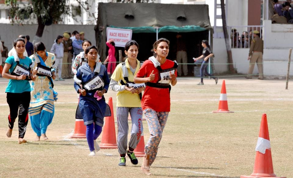 Female candidates running during  a recruitment rally of Jammu and Kashmir Police (JKP) , in Jammu, on Monday. (Nitin Kanotra / Hindustan Times)