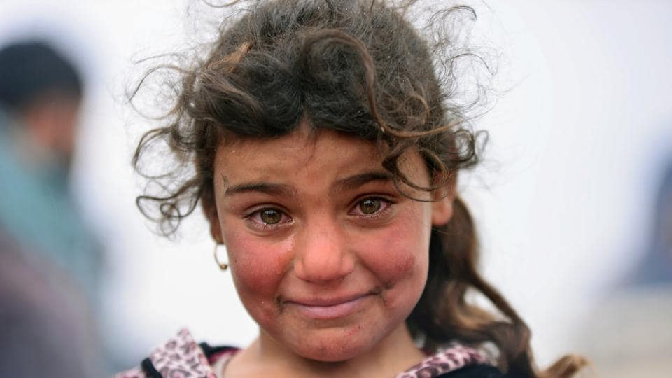 A displaced Iraqi girl, who fled her home, cries during a battle between Iraqi forces and Islamic State militants, near Badush, Iraq. The number of children maimed, killed or recruited to fight in the Syria conflict has increased dramatically over the past year. (REUTERS)