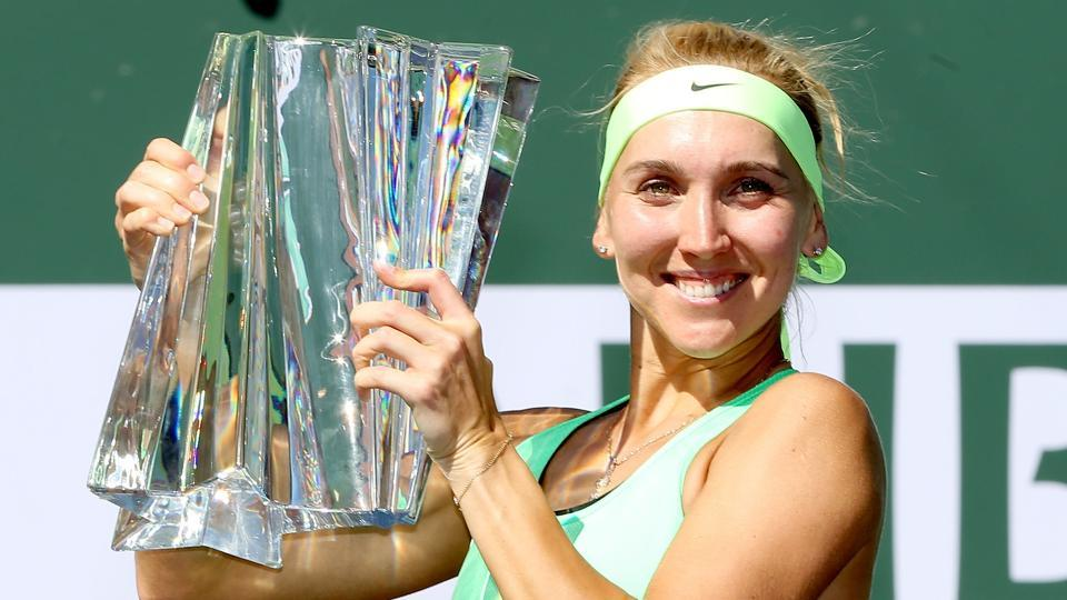Elena Vesnina celebrates with the Indian Wells trophy after defeating Svetlana Kuznetsova.