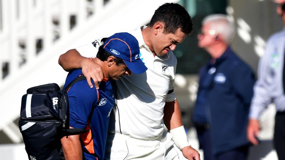 Ross Taylor (R) is helped from the field injured during day two of the first Test match between New Zealand and South Africa at the University Oval in Dunedin on March 9, 2017.