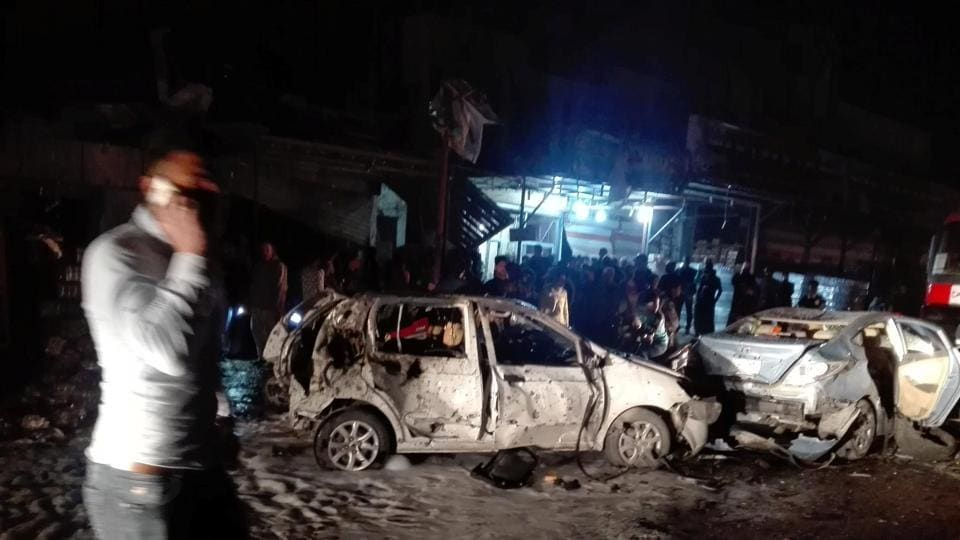 Destroyed cars are seen at the site of a car bomb attack in the Amil neighborhood in Baghdad, Iraq, March 20, 2017.