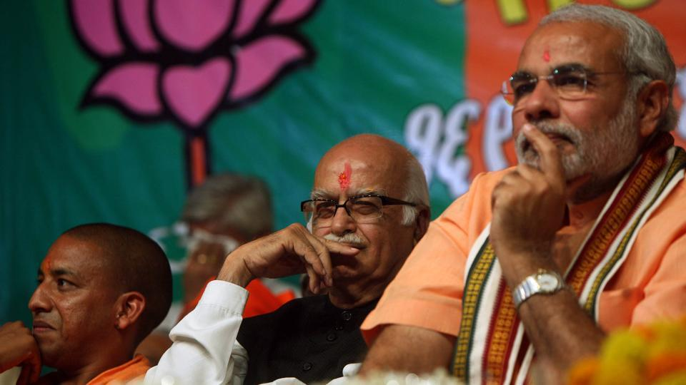 Prime Minister Narendra Modi with BJP leader LK Advani and UP chief minister Yogi Adityanath.