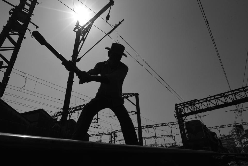 Gangmen or track maintainers walks miles every day, checking for rail fractures and making sure every joint is in place. Here, gangman Rahul Kumar hammers a bolt back in place on the tracks near Mumbai's bustling Chhatrapati Shivaji Terminus, or CST. (Pratik Chorge/HT PHOTO)