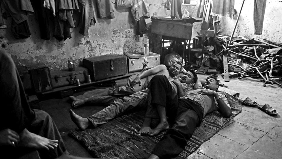 The tapri is a bare bare room with hooks in place of furniture. There is no running water and no toilet. There's a mat the men share in place of a bed; tools and parts are piled to one side.  (Pratik Chorge/HT PHOTO)