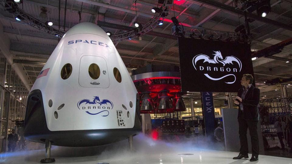 SpaceX CEO Elon Musk (R) unveils the Dragon V2 spacecraft in Hawthorne, California, on May 29 in 2014.