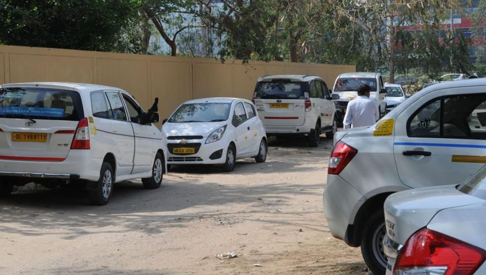 Taxis parked on a vacant plot at M block, DLF 2.