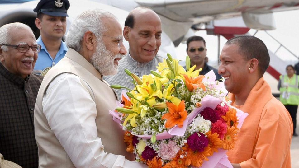 Uttar Pradesh chief minister Yogi Adityanath welcomes Prime Minister Narendra Modi before the swaering-in ceremony in Lucknow on Sunday.