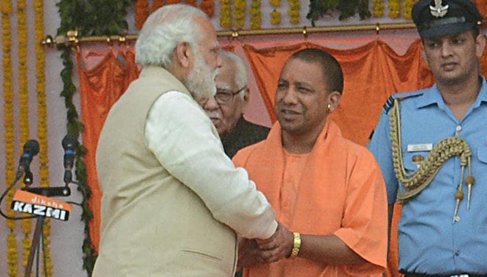 Prime Minister Narendra Modi greets Yogi Adityanath, who was sworn in as the Uttar Pradesh chief minister in Lucknow on Sunday.