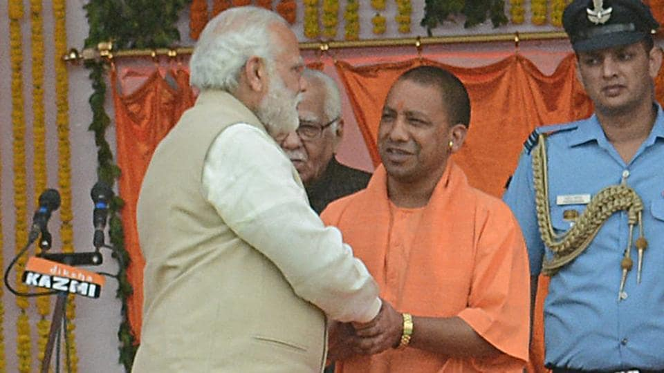 Prime Minister Narendra Modi greets Adityanath during his swearing-in ceremony as Uttar Pradesh chief minister on March 19.