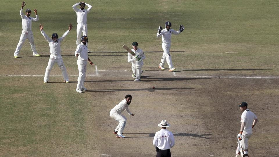 India cricket team players, along with bowler Ravindra Jadeja appeal unsuccessfully for the dismissal of Australia cricket team's Peter Handscombon Day 5 of the third Test in Ranchi on Monday