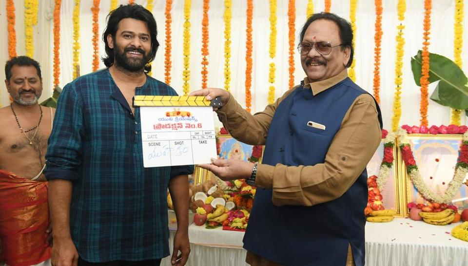 Prabhas with his uncle, yesteryear actor Krishnam Raju at the launch of his film with Sujeeth.