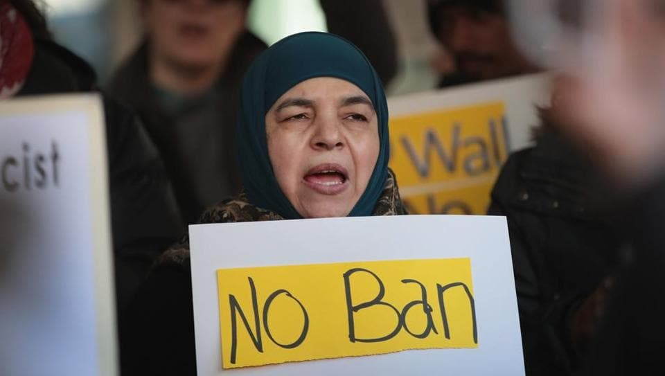 Demonstrators protest outside the office of Immigration and Customs Enforcement (ICE) against Trump's revised travel ban on March 16, 2017 in Chicago, Illinois.