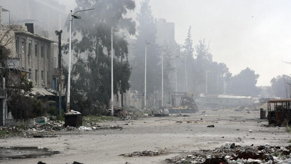 In this photo released by the Syrian official news agency SANA, damaged and blocked street where clashes erupted between the Syrian government forces and rebels, near the Abbassiyin square, east Damascus, Syria, Monday March 20, 2017.