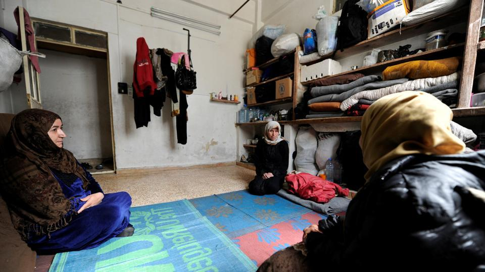 Un Ghazi (C), mother of cancer patient Ghazi, rests near other women inside a shelter provided by Basma. President Bashar al-Assad has partly blamed the sanctions for turning many Syrians into refugees, often heading to Europe. (Omar Sanadiki/REUTERS)