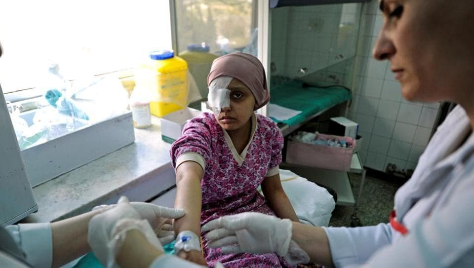 Nurses tend to a child with cancer at Damascus Children's Hospital in Damascus, Syria. In the cancer ward at Damascus Children's Hospital, doctors are struggling with a critical shortage of specialist drugs to treat their young patients - and it's not just due to the general chaos of the Syrian civil war. (Omar Sanadiki/REUTERS)