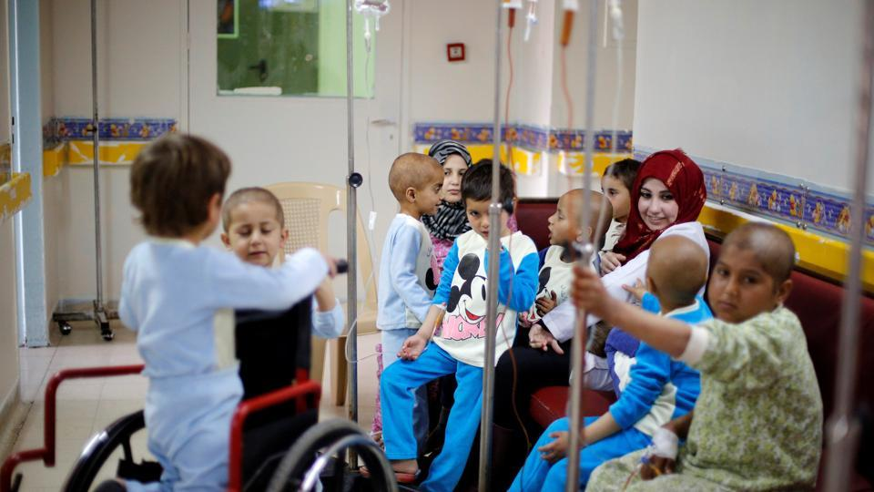 Children with cancer sit at Damascus Children's Hospital in Damascus, Syria.  Before the conflict, Syria produced 90 percent of the medicines it needed but anti-cancer drugs were among those where it traditionally relied on imports. (Omar Sanadiki/REUTERS)