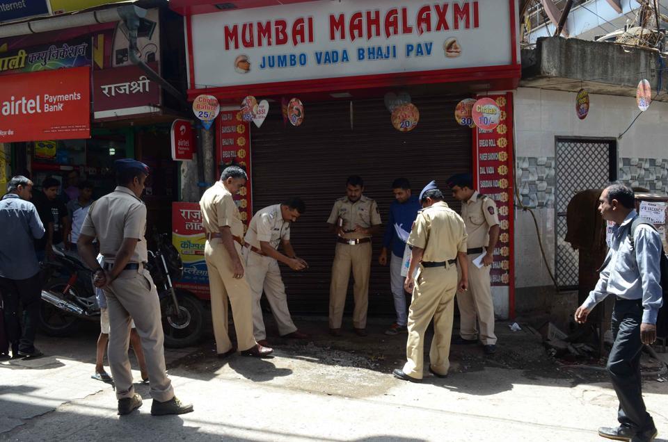 Vithalvadi police inspect the spot where the owner of Mumbai Mahalaxmi Jumbo Vada bhaji pav centre was set alight.