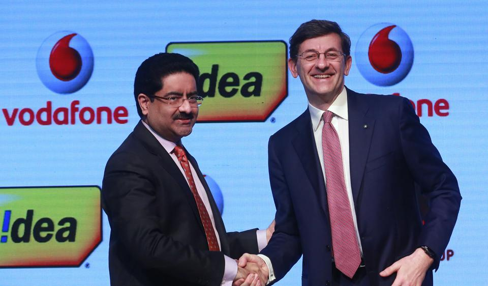 Vodafone Group CEO, Vittorio Colao, right, shakes hand with Aditya Birla Group chairman, Kumar Mangalam Birla after a press conference in Mumbai on Monday, March 20, 2017.