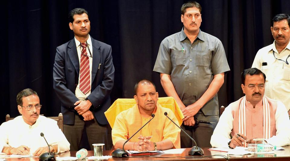 UP Chief Minister Yogi Adityanath with deputy CMs Dinesh Sharma and Keshav Prasad Muriya at a meeting of police officers in Lucknow on Monday, March 20, 2017.