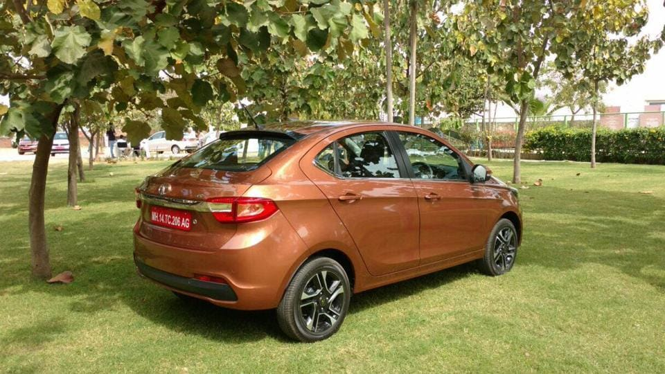 The Tigor is Tiago from the front, but it gets a stylish fastback rear design that stands out in the compact-sedan segment.