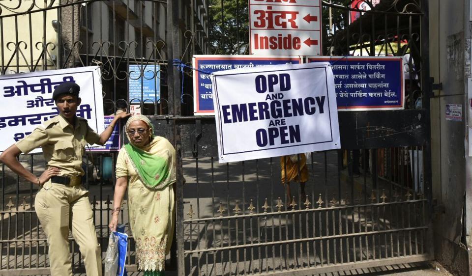 A policewoman outside a  hospital on Tuesday.