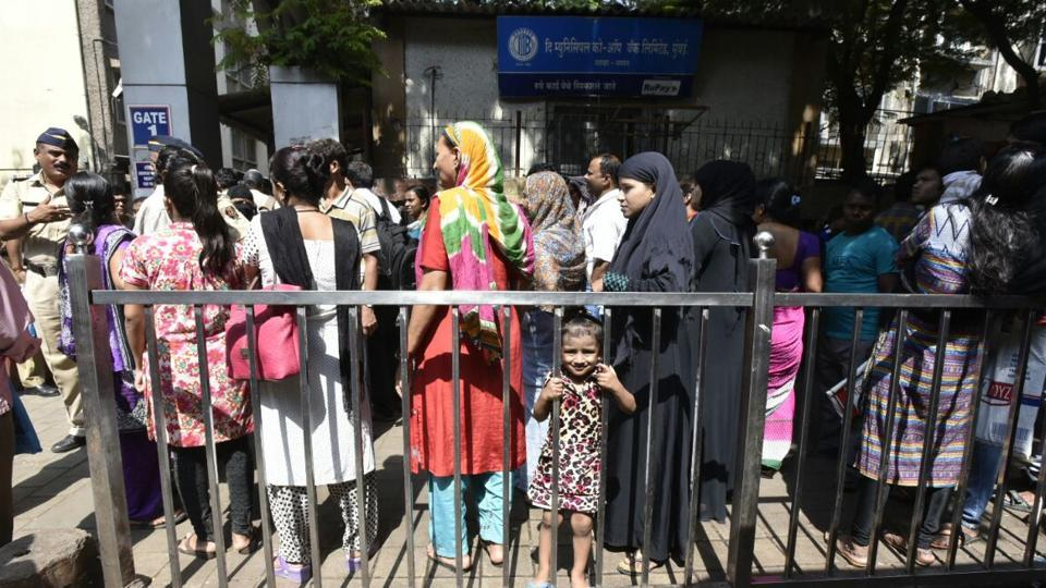 Patients and their relatives queue up outside a hospital in Mumbai on Tuesday.
