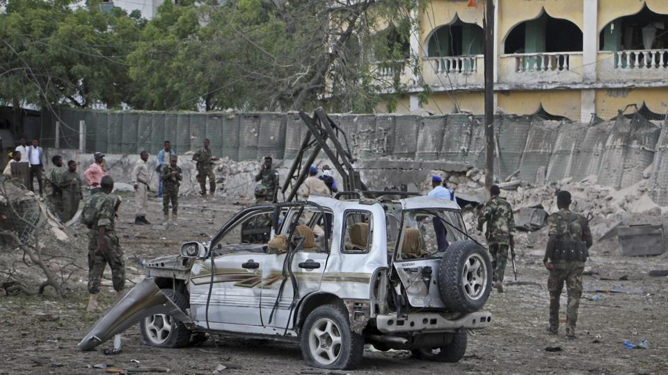 Mogadishu : Somali soldiers stand near the wreckage of a car bomb attack that targeted a checkpoint in Mogadishu, Somalia Tuesday, March 21, 2017.