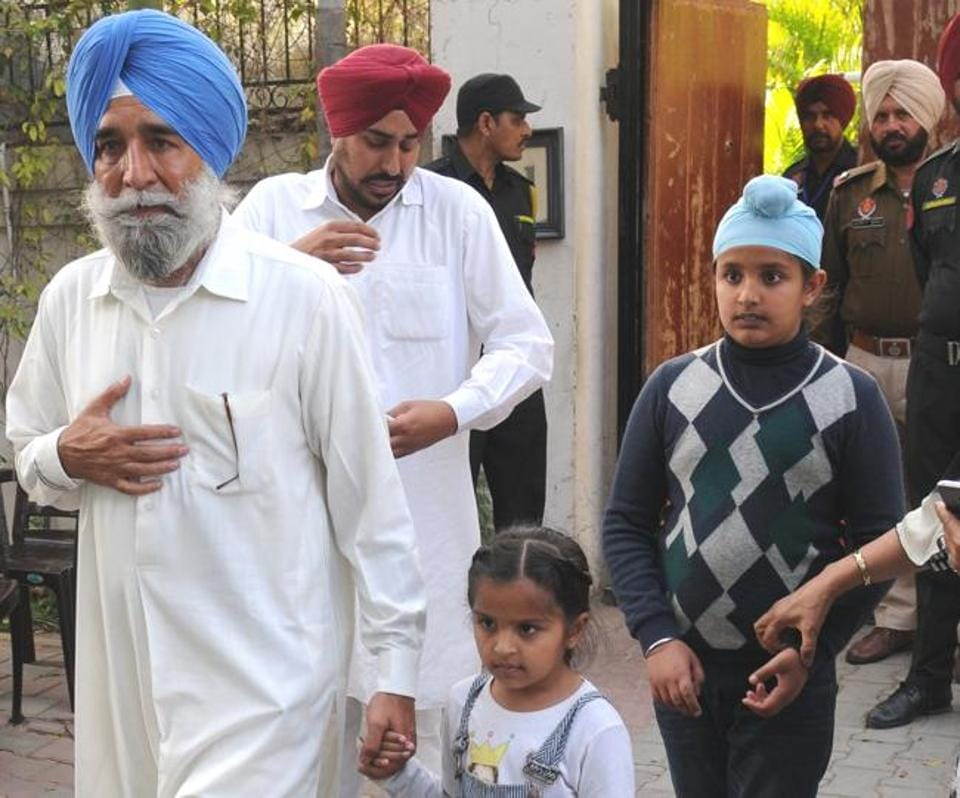 The deceased's father Jaspal Singh Dhillon and brother Darshan Singh Dhillon with his children after meeting the Punjab CM in Chandigarh on Monday.