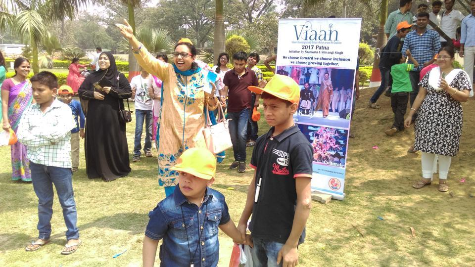 Children, along with their parents and teachers, participate at 'Buddy Walk' event to create awareness about Down syndrome, in Patna.