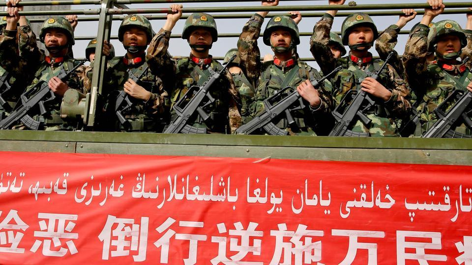 Chinese military police attend an anti-terrorist oath-taking rally in Hetian, northwest China's Xinjiang Uighur Autonomous Region.