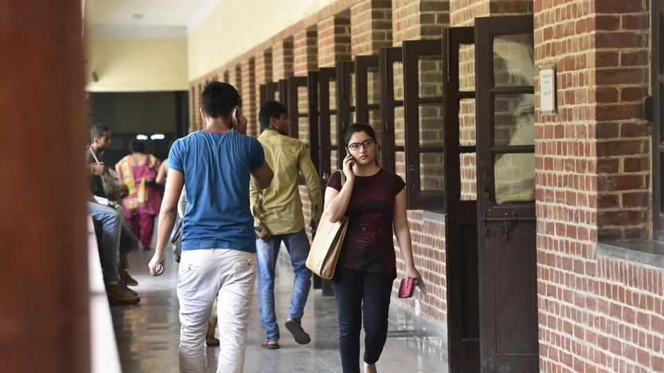 More than 9,000 ad-hoc posts of teachers in Delhi University will be regularised within a year, the government said on Monday.