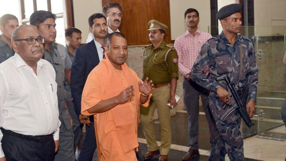 Uttar Pradesh chief minister Aditya Nath arrives at the Lok Bahvan on Monday for his first meeting with government officials at the secretariat.