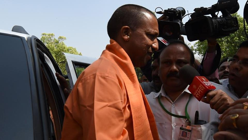 Uttar Pradesh chief minister Yogi Adityanath arrives at Parliament to meet Prime Minister Narendra Modi in New Delhi on Tuesday.