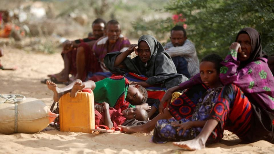 Internally displaced Somali families rest as they flee from drought stricken regions in Lower Shabelle region before entering makeshift camps in Somalia's capital Mogadishu.