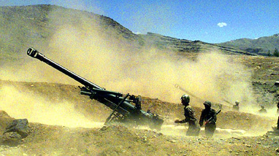 Indian soldiers fire a howitzer in Kargil, Jammu and Kashmir.