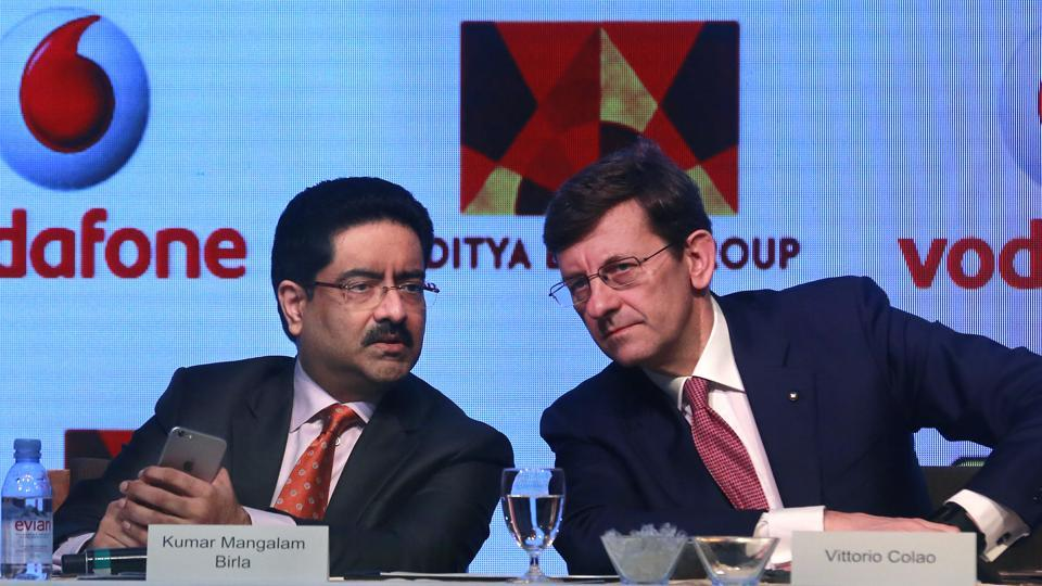 Aditya Birla Group chairman, Kumar Mangalam Birla, left, with Vodafone Group CEO Vittorio Colao, during a press conference in Mumbai.