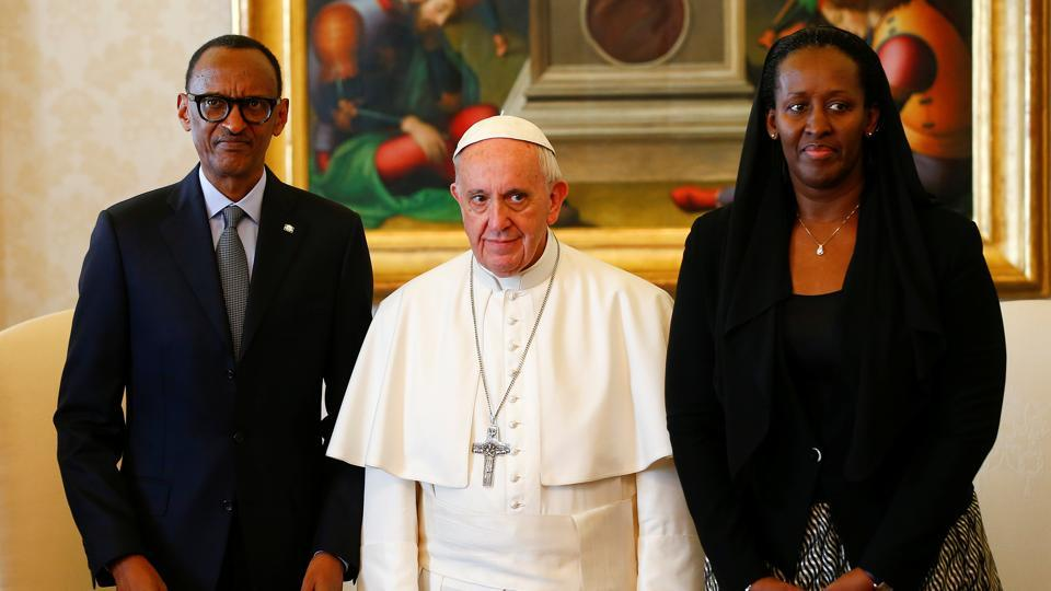 Pope Francis poses with Rwanda's President Paul Kagame and his wife Jeannette during a private meeting at the Vatican.