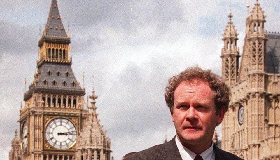 In this May 13, 1997 file photo Sinn Fein's Martin McGuinness walks past the Houses of Parliament in London.