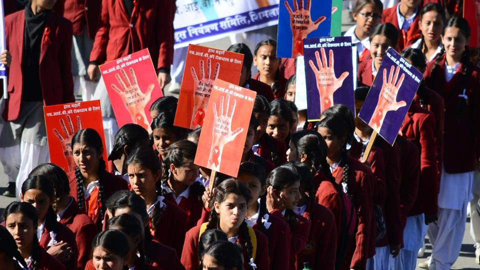 School children take out a rally to spread awareness on HIV and AIDS at Ridge, Shimla, recently.