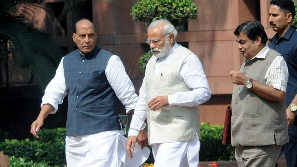 Prime Minister Narendra Modi with home minister Rajnath Singh and roads and transport minister Nitin Gadkari after a cabinet meeting at Parliament Library in New Delhi.
